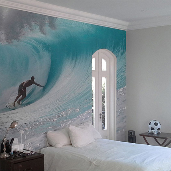bedroom wallpaper of surfer riding a barreling wave
